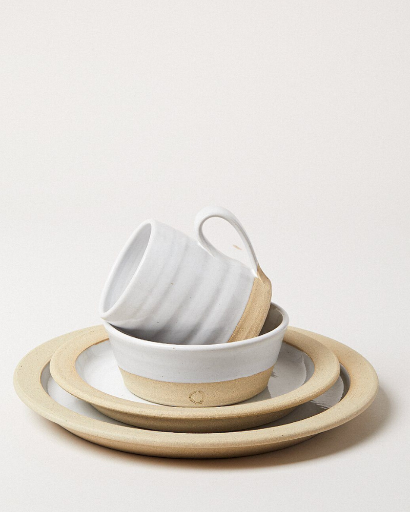 Stoneware mug, bowl, and plates in gray and beige