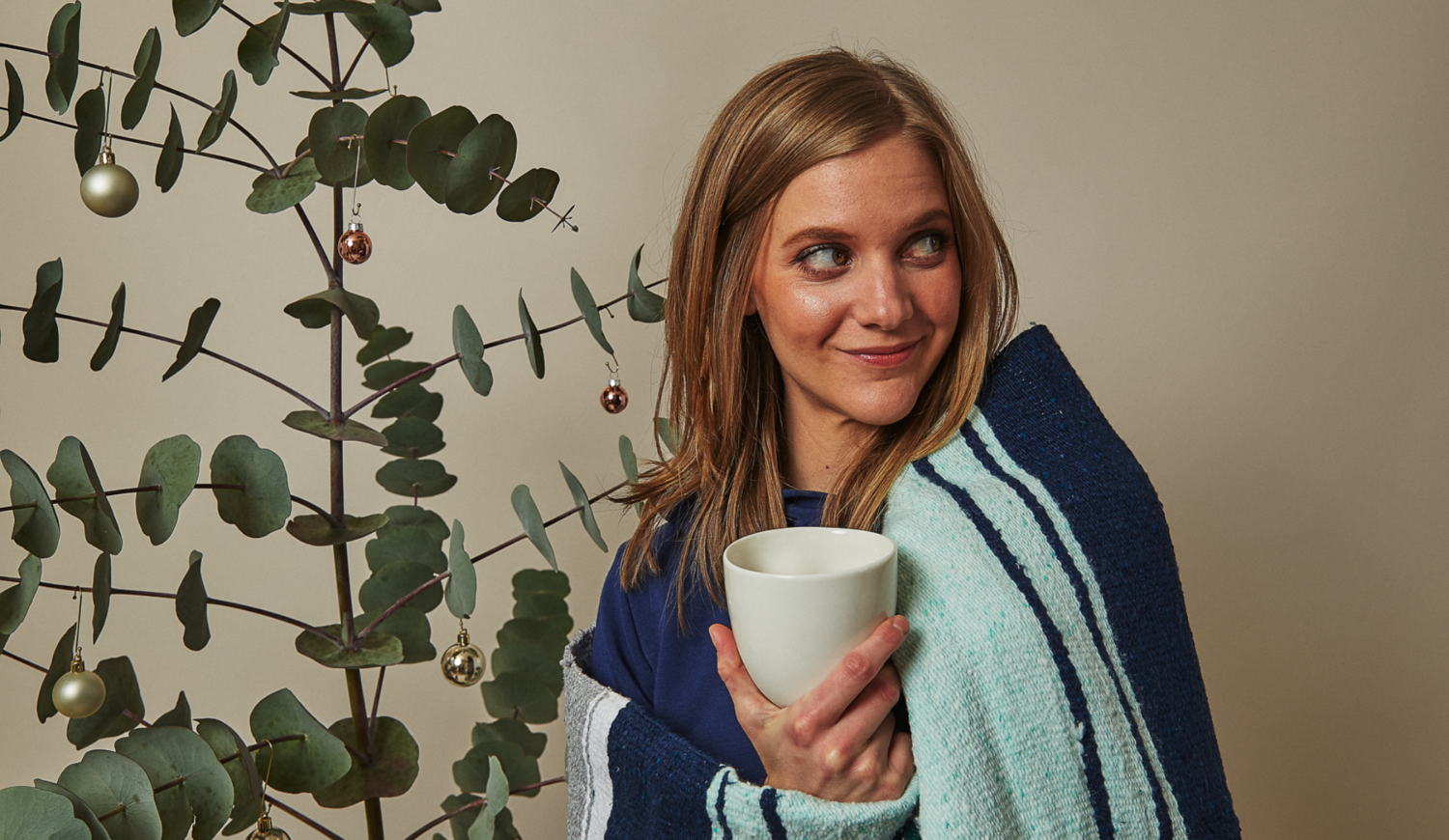 cozy with a mug and blanket