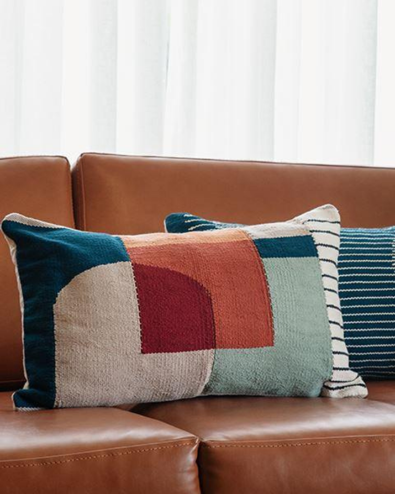 Colorful lumbar pillow with geometric designs
