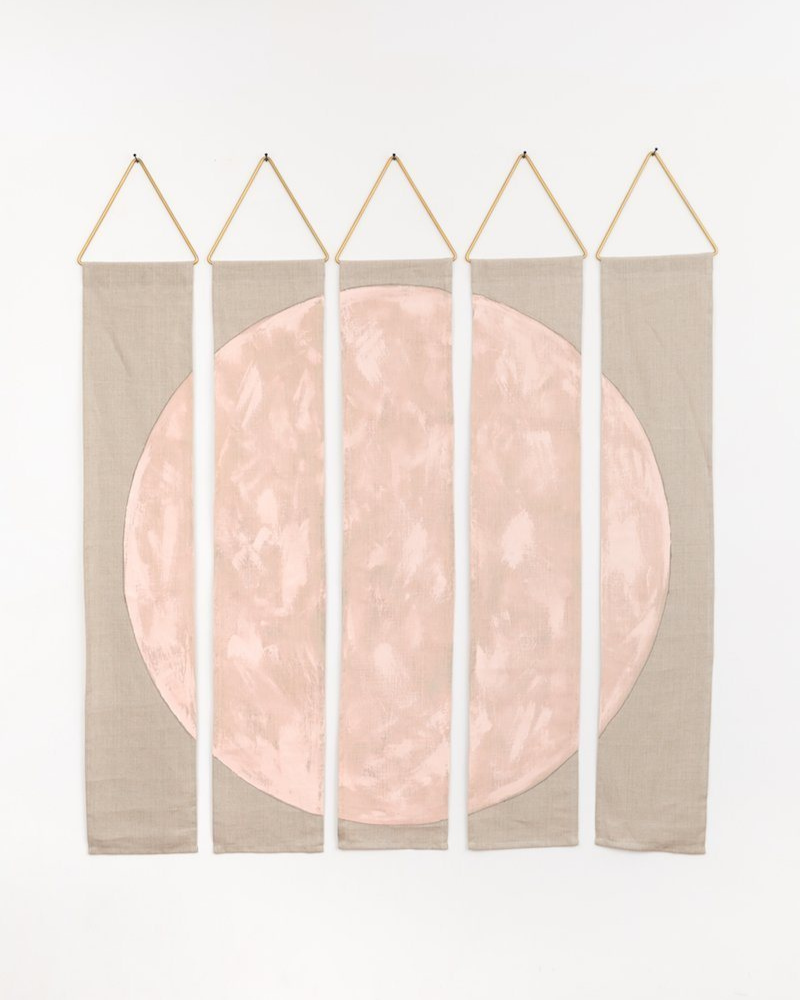 Blush linen wall hanging with blush circle painted in the middle