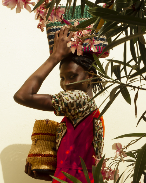 Woman Holding Handwoven Baskets