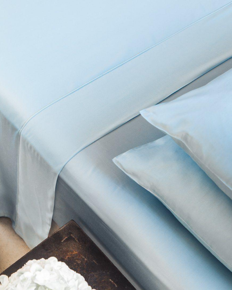 Baby blue sheets and pillows