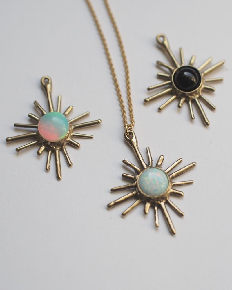 Iron Oxide choker pendants made with lab-grown gemstones like opal and turquoise opal