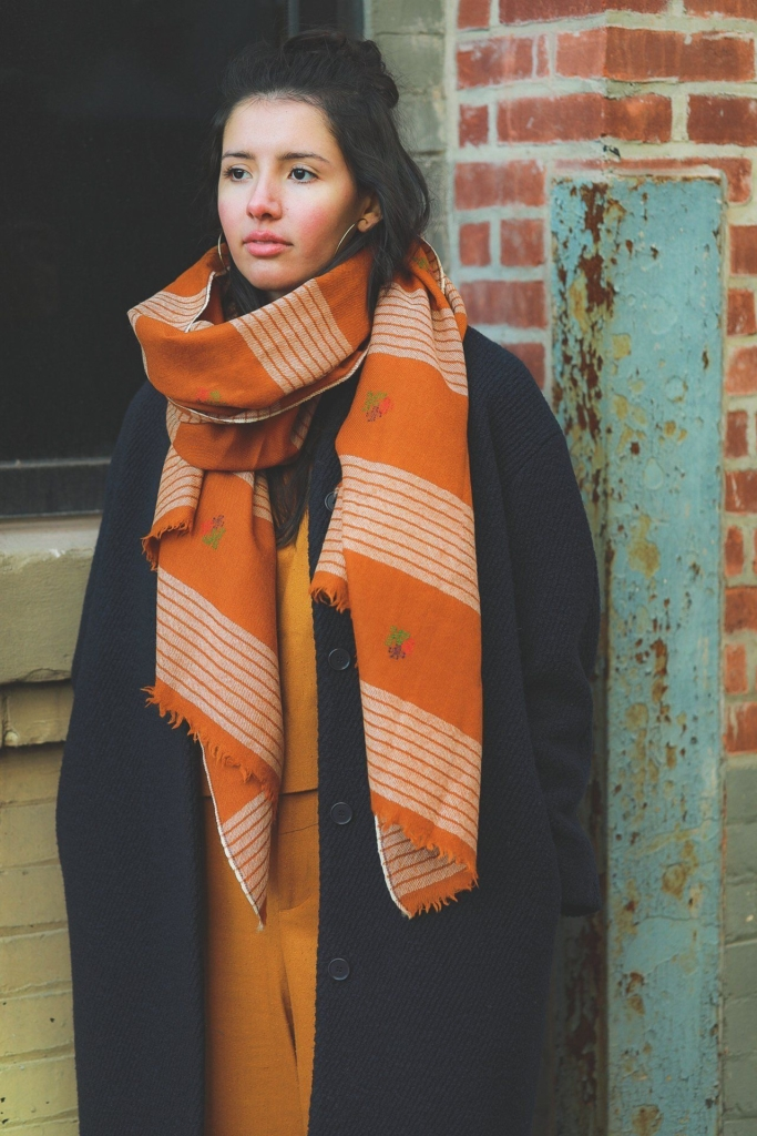 woman wearing orange scarf