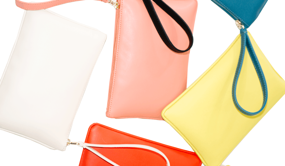A collection of colorful vegan handbags and clutches